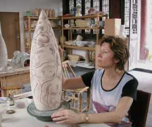 "2005, ""The Sculpture Factory"", Great Master Liu's Fragrant Garden studios, Jingdezhen. Diana working on The High-Fired Series. Carving & Under-Glaze painting."
